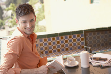 Man enjoying espresso in outdoor cafe