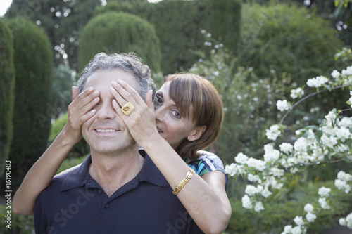 Woman covering boyfriends eyes