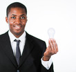 Afro-American businessman holding a light bulb