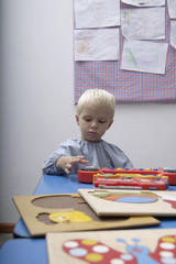 Boy playing with toys in school