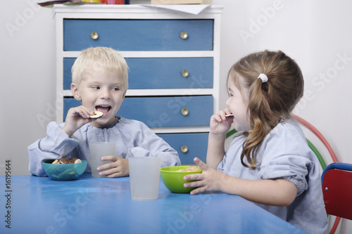 Children eating snacks in classroom