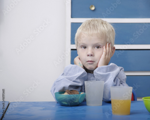 Boy eating snack in classroom