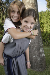 School girl carrying friend on back