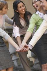 Businesswomen in a huddle
