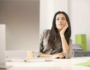 Businesswoman thinking at desk