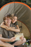Couple hugging at campsite