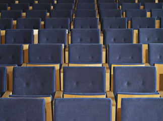 Rows of empty seats in conference room