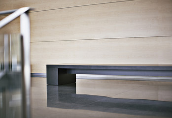 Bench in modern office lobby