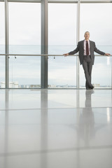 Businessman standing in modern lobby