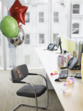 Birthday balloons tied to office chair