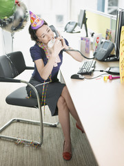 Businesswoman having birthday party at desk
