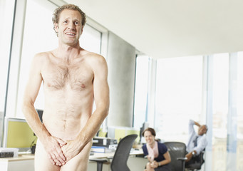Naked businessman in office