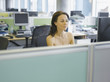 Naked businesswoman working at desk