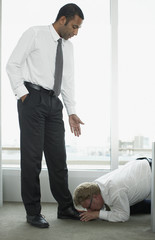 Businessman kissing boss? feet