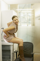 Businesswoman photocopying her buttocks