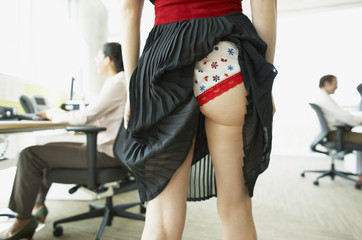 Businesswoman with skirt caught in underwear