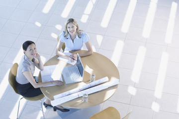 Businesswomen having meeting in lobby