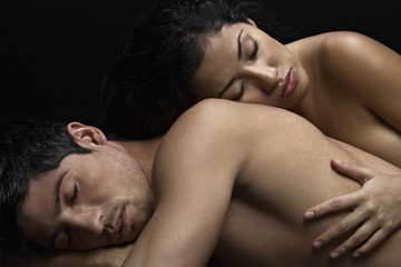 Nude couple sleeping