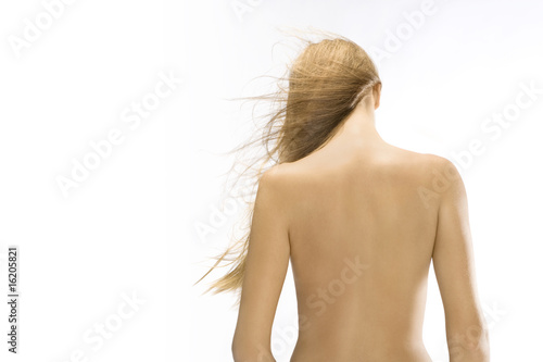 Nude woman with wind-blown blonde hair