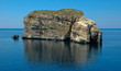 Giant Rock and Small Boat outside Malta