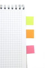 Notebook with sticky bookmarks, on white background.