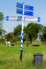 Direction sign of a road in the countryside
