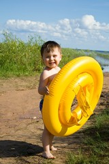 Little boy with a lifebuoy ring