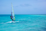 windsurfer on blue water