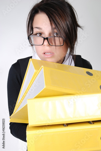confused businesswoman with folders
