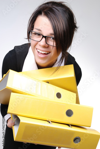 businesswoman trying to keep the folders