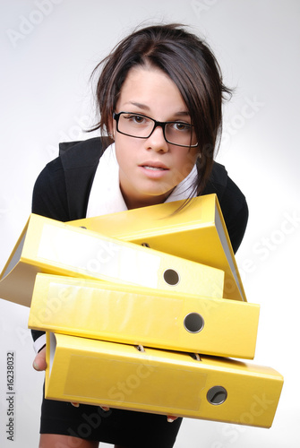 confused businesswoman trying to keep the folders