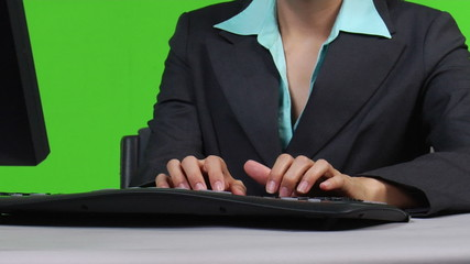 Female supervisor typing on computer - zoom out - green screen