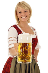 Junge Frau im Dirndl mit Maßkrug Bier