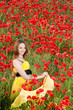 Attractive girl in poppy field