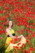 Attractive girl in poppy field