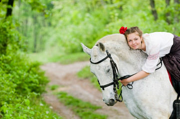 Cute girl riding horse