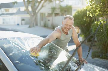 Man washing car windshield