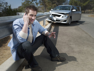 """Man with crashed car calling for roadside assistance,"""