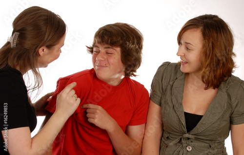 three friends or siblings playing around on white background