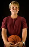 teen boy holding basketball