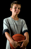 Happy young basketball player