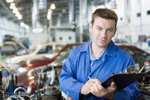 Technician working in auto shop