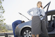 Businesswoman waiting for mechanic to fix car