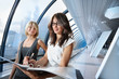 Team of two businesswomen meeting in futuristic interior