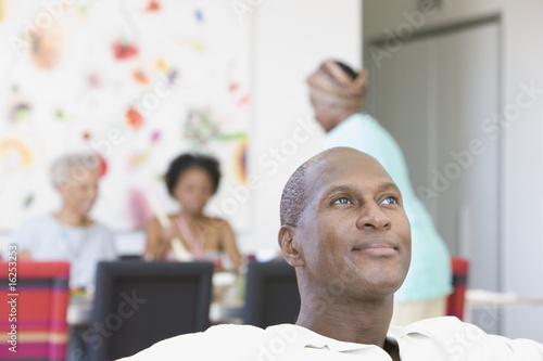 Portrait of man at home with family