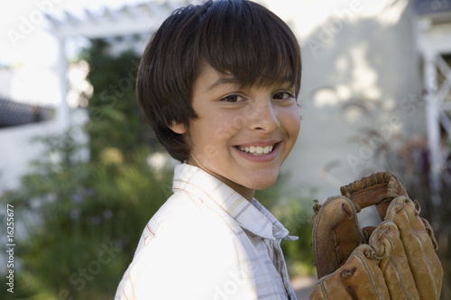 Boy holding baseball glove