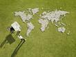 Businessman working near?world map made of rocks