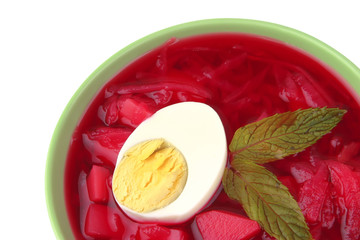 red vegetable soup over white