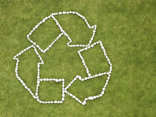 Recycling symbol made of rocks