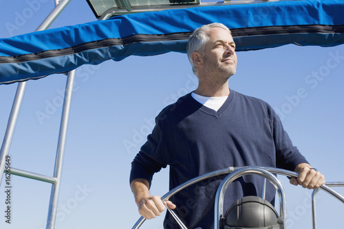 Man steering boat